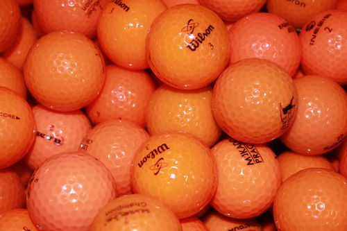 50 orange Golfbälle in AA